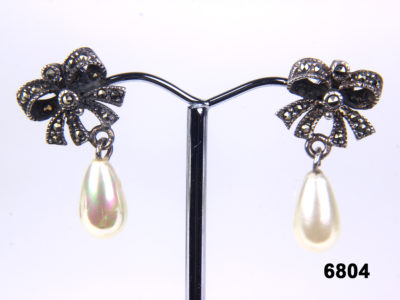 Vintage 925 Sterling silver pearl earrings with marcasite bows from antiques of kingston
