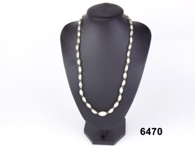 Art Deco mother-of-pearl necklace with pearl glass faceted spacers from Antiques of Kingston
