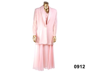 Pale pink evening suit consisting of maxi skirt and jacket with lightly padded shoulders and sewn-in waistcoat by Vasilia of London from Antiques of Kingston Size 12 100% Polyester / Hand wash only