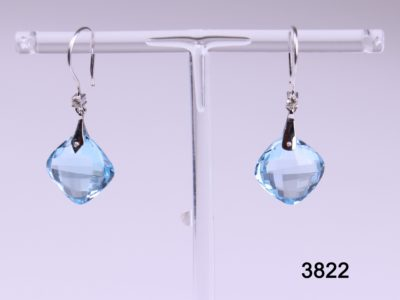 18 carat white gold hook earrings with cushion cut blue topaz drop and small diamond on hook base from antiques of kingston