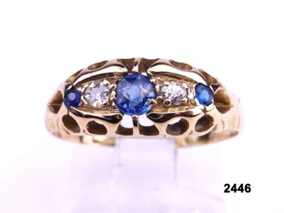 18 carat gold ring set with cornflower blue sapphires and diamonds from Antiques of Kingston