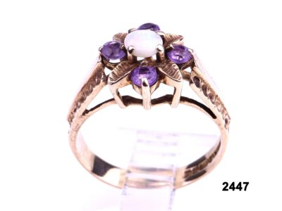 9 carat gold ring set with small opal cabochon to centre with small round cut lilac amethyst stones from Antiques of Kingston