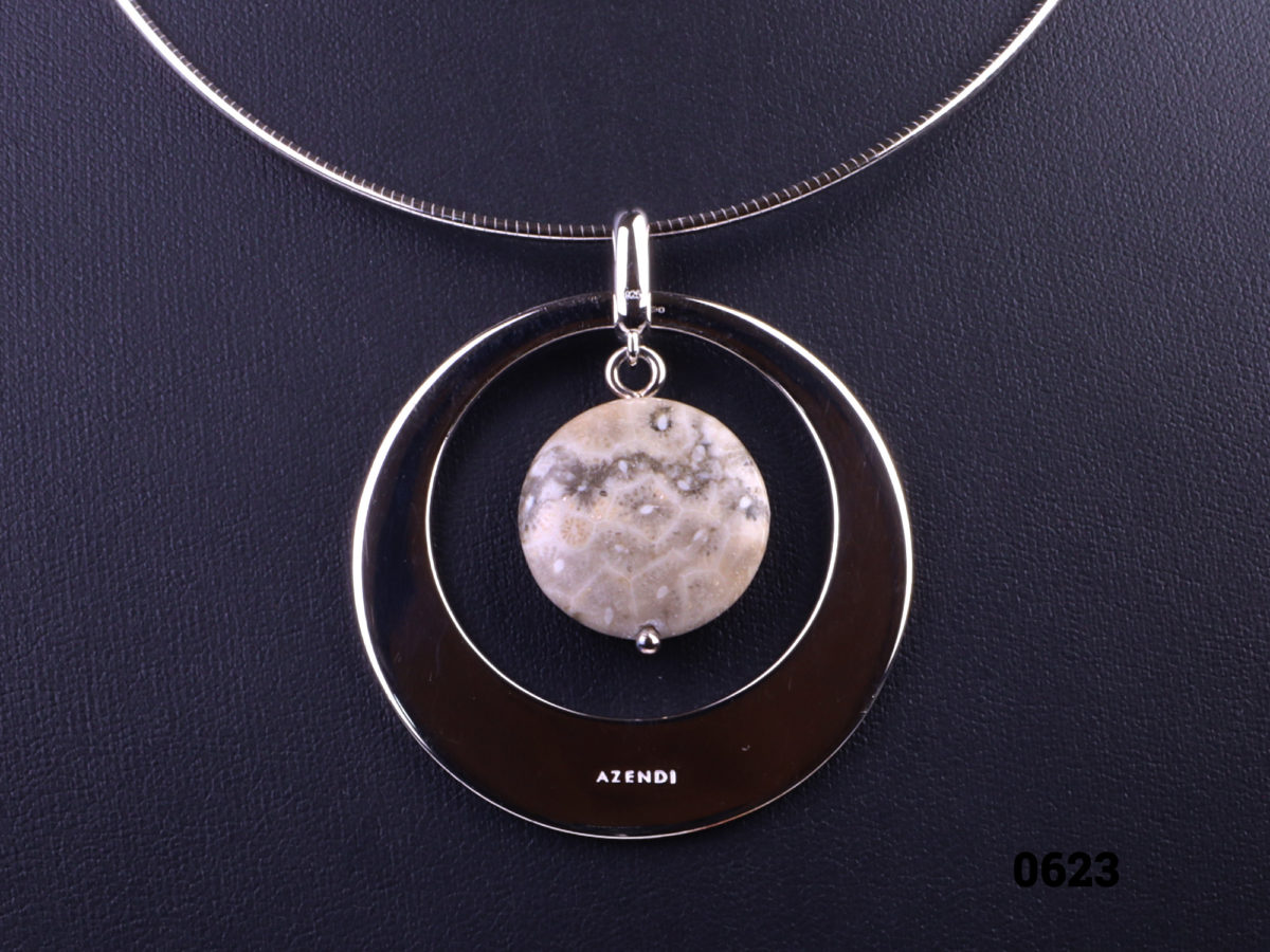 Sterling silver snake chain necklace with a jasper stone pendant set in sterling silver circle frame