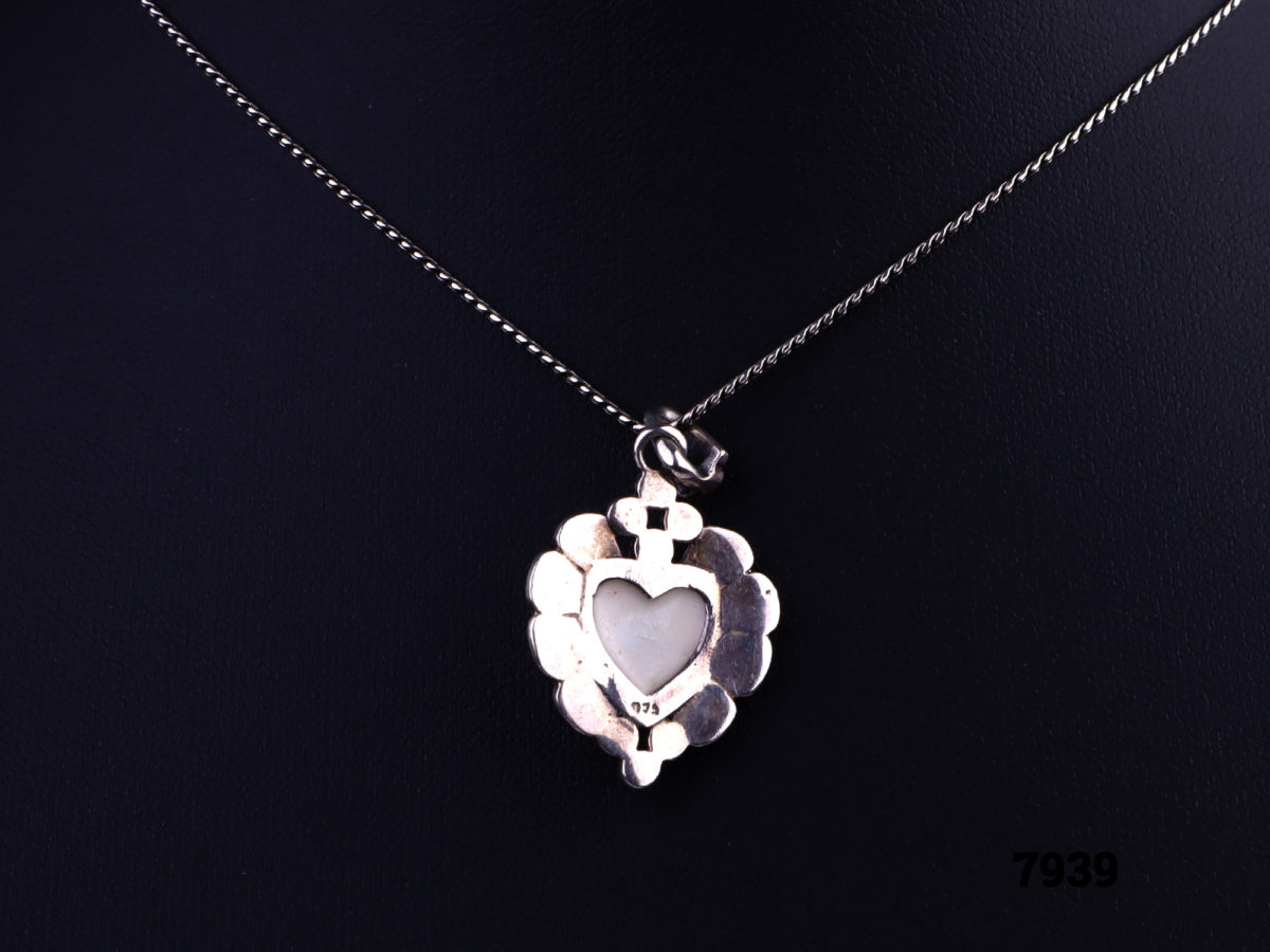 925 Sterling silver necklace with a sterling silver marcasite and white shell heart pendant Image of reverse of pendant showing 925 hallmark