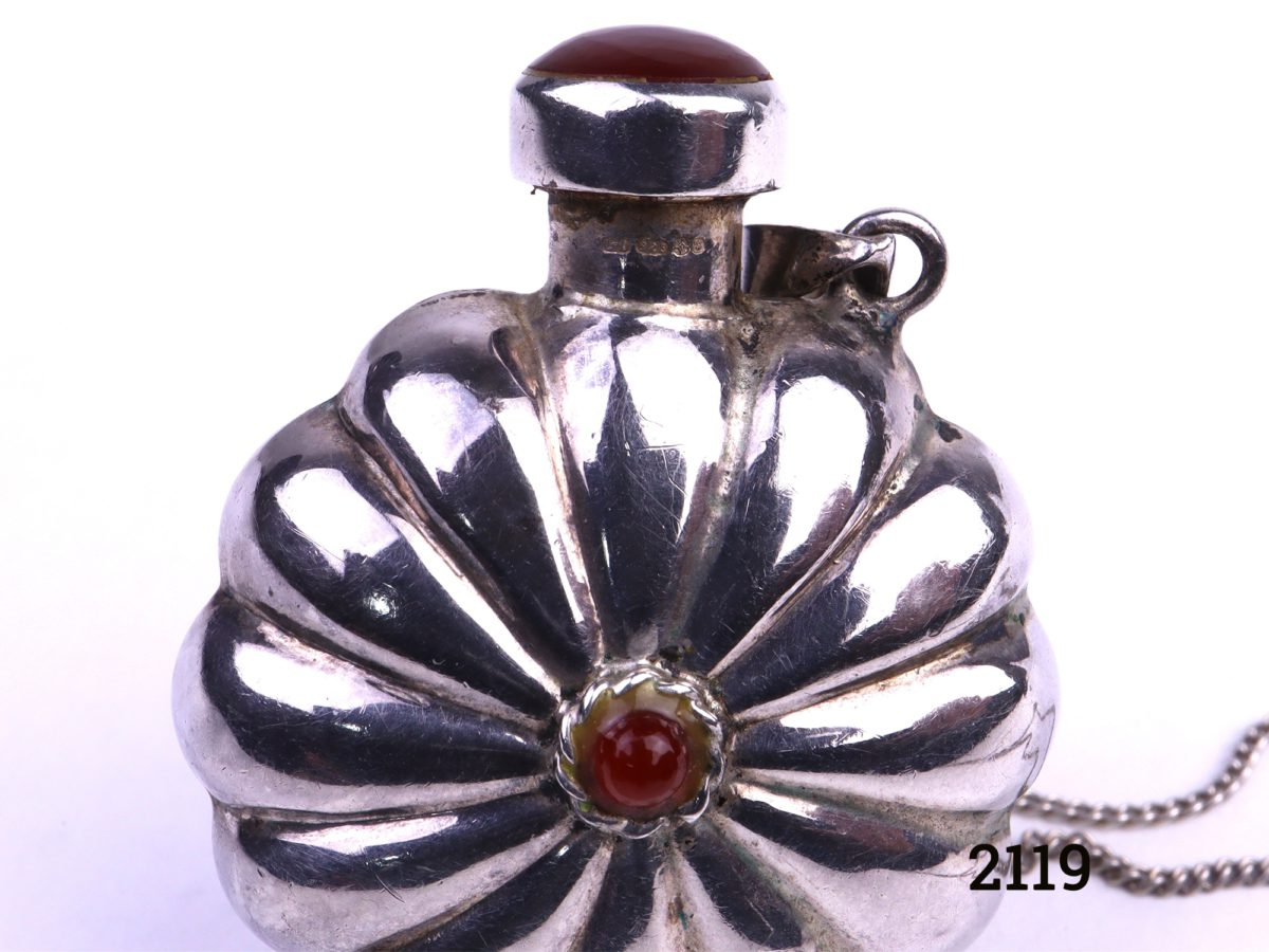 Silver scent bottle pendant on chain with carnelian stone accent Photo showing close up of scent bottle with hallmark below the applicator lid