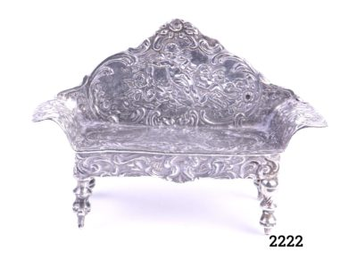 925 Sterling silver miniature bench embossed with cherubs Hallmarked 925 for sterling silver on the top of backrest on back of bench Main photo showing front of bench