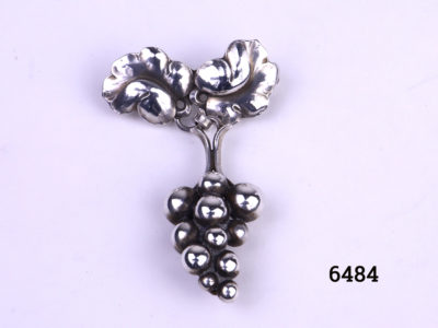 Georg Jensen Arts & Crafts sterling silver brooch in the form of a bunch of grapes hanging loosely from the vine leaves Unusually hallmarked Georg Jensen Silversmiths LTD 925S Denmark 217A Main photo of front of brooch
