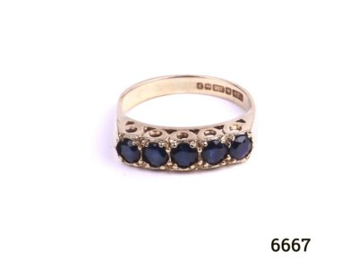 c1980 Birmingham assayed 9 carat gold ring with 5 small sapphires by goldsmiths PDL. Size L / 5.75. Ring weight 2.8g. Main photo showing front view of ring on flat surface.
