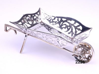 Small sterling silver wheelbarrow with filigree scroll work on all the sides Made by M & C Lister c1934 Birmingham assayed Main photo showing angled front and side view