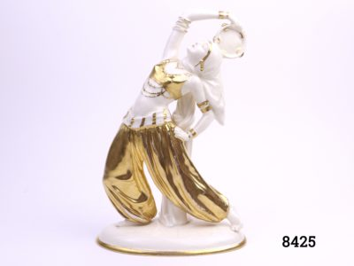 Art Deco porcelain figure of a Bedouin dancer with a tambourine in hand-painted gold hi-lights Made in Sitzendorf, Germany (Restoration work to tambourine, some crazing & cracking and wear to gold) Main photo showing front view of dancer