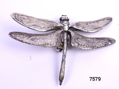 Silver plate dragonfly brooch with iridescent blue and green sparkling wings and tail end Main photo showing brooch front