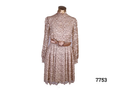 1960s Lace dress in shades of coffee cream Fully lined (Very small opening to get hand through the arm only 75mm across !) Size 6 or small size 8 Main photo of front of dress displayed on a mannequin