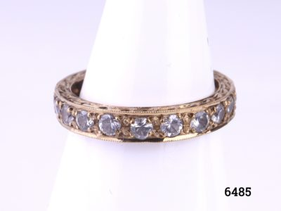 9ct Gold Art Deco eternity ring with cubic zirconia Size O / 7.25 Ring weight 2.4g Main photo of ring displayed on a stand from Antiques of Kingston