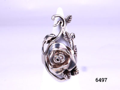 925 Silver rose flower ring. Hallmarked 925 for sterling silver. Size K.5 / 5.5. Ring front measures 35mm long by 20mm wide. Main photo showing front view of ring displayed on a stand.