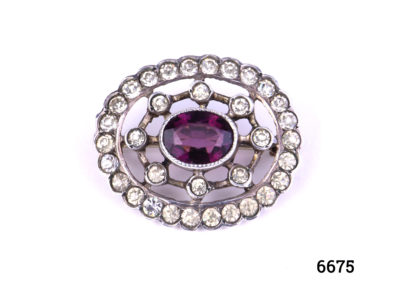 Vintage Continental silver brooch with oval cut amethyst to the centre surrounded by rhinestones. Hallmarked 800 silver. Brooch weighs 4.8grammes and measures 25mm by 20mm Main photo showing frontage of brooch