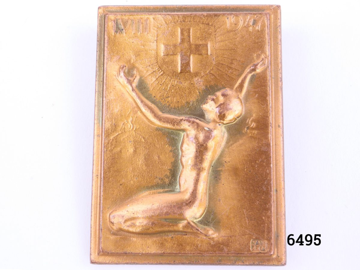 Vintage Swiss Red Cross badge designed by Huguenin from Le Locle region in Switzerland and signed by Hans Frei to the front In coppered bronze with pin in good order Main photo of badge front under studio light